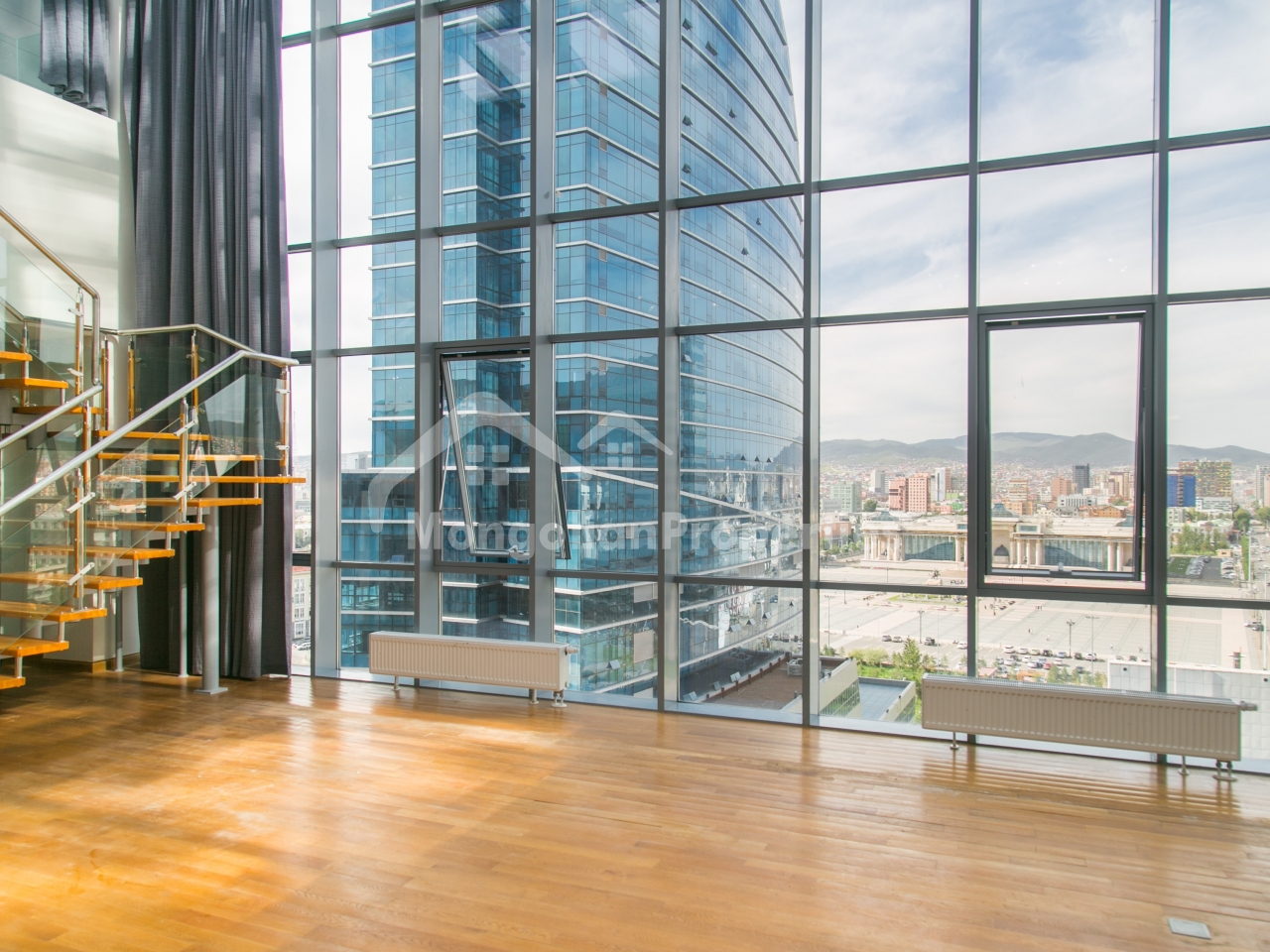 FOR RENT: Choijin Suites, 344m2, 3 bedroom, 1 office and 4.5bath Penthouse with killer 2 terraces and 1 indoor terrace facing Sukhbaatar Square and Bogd Mountain
